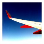 Flying Away, in the Window Seat